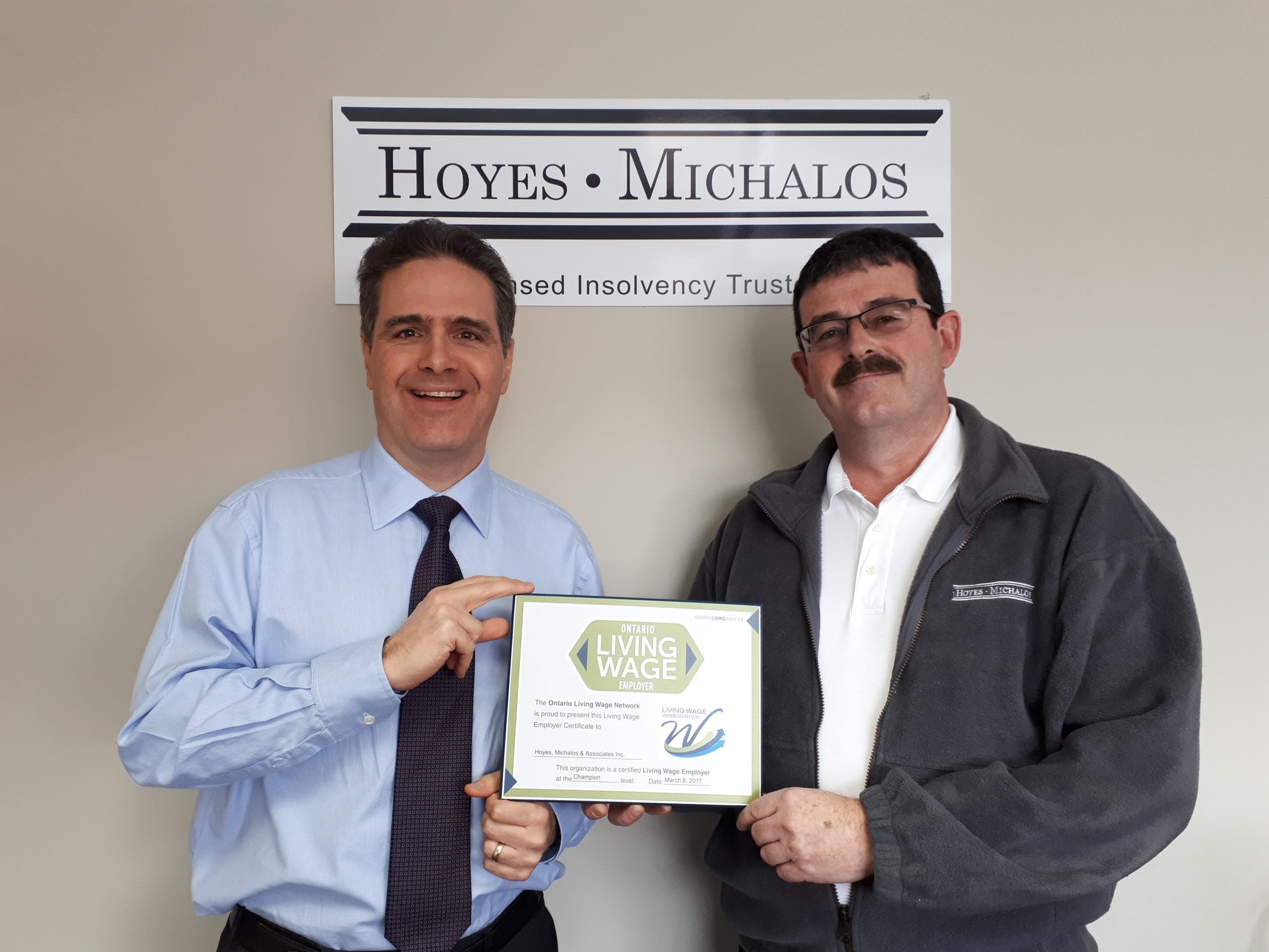 Doug Hoyes and Ted Michalos holding Living Wage plaque