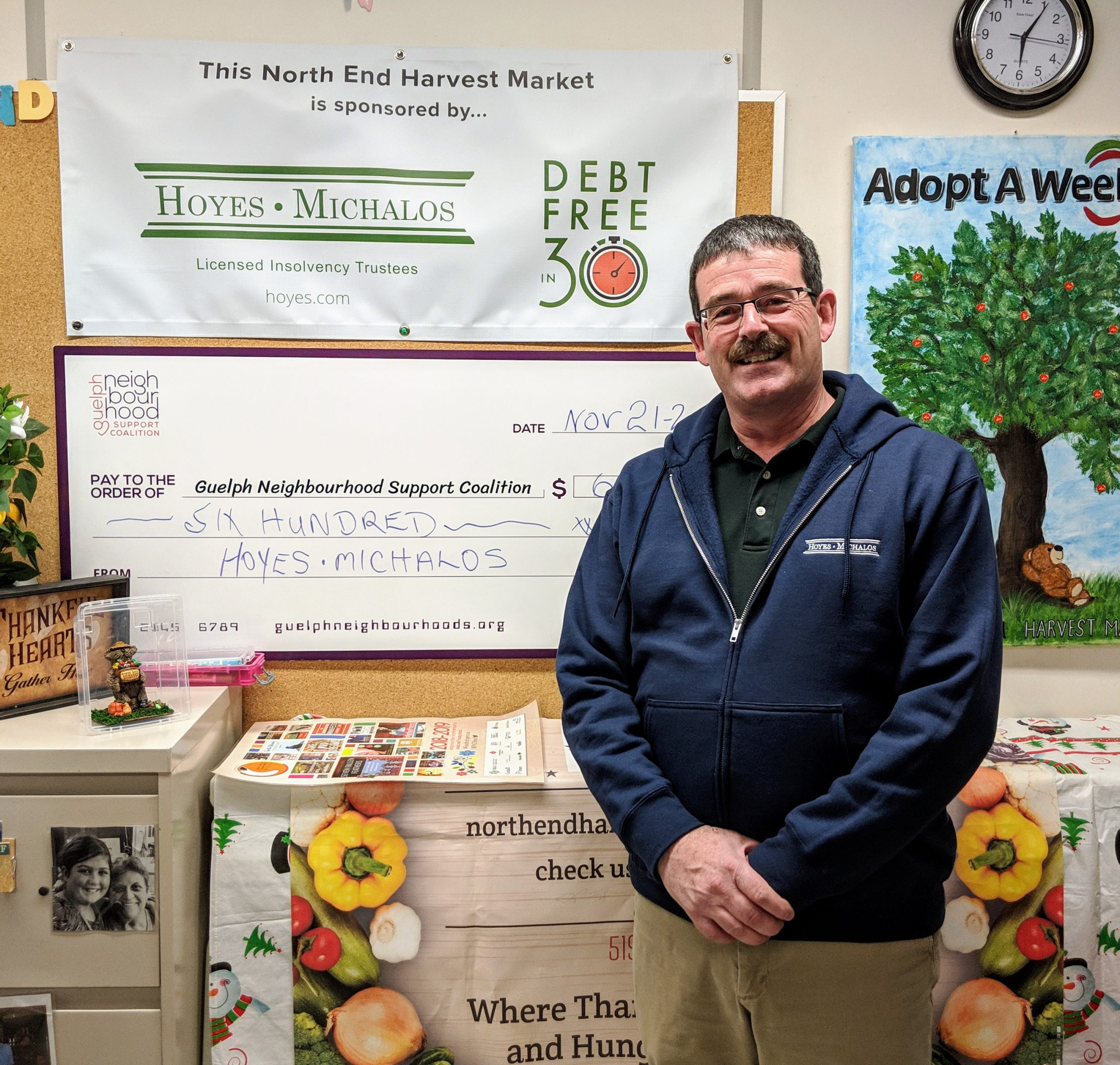 Ted Michalos with cheque to the North End Harvest Market