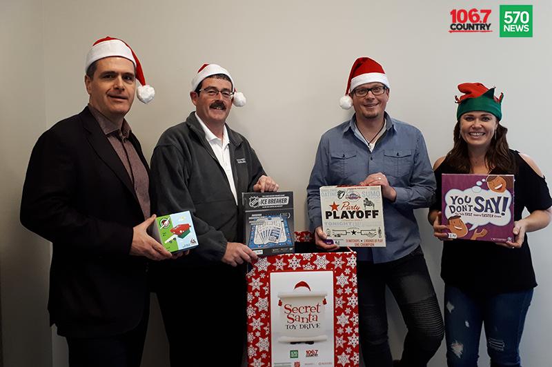 Doug Hoyes, Ted Michalos and 570 News radio crew posing for Secret Santa sponsorship
